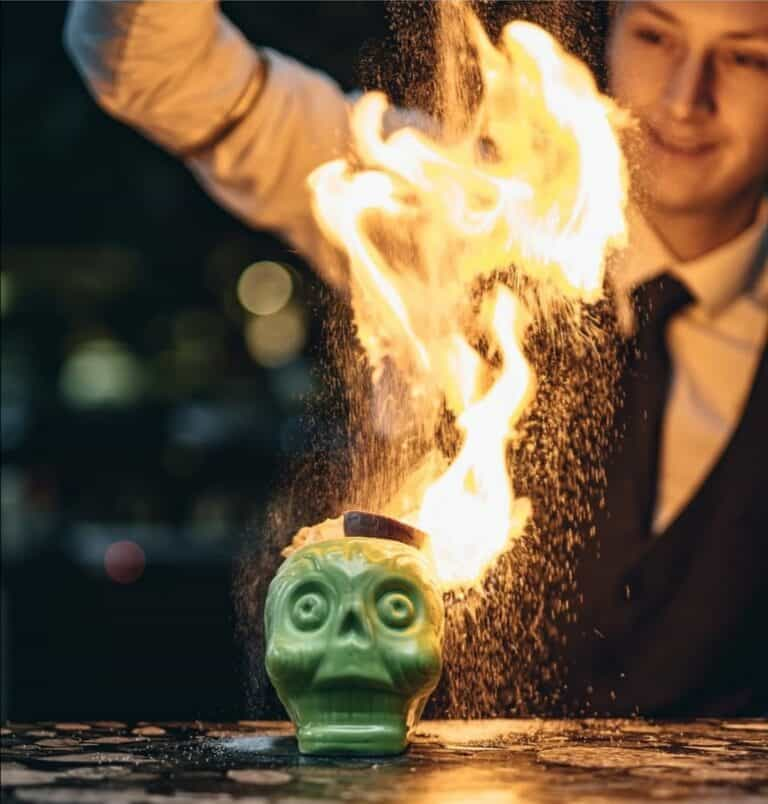 Zombie cocktail flames with cinnamon