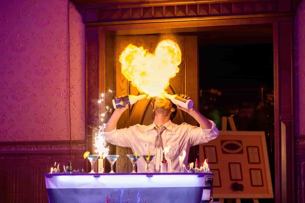 Flair bartender hire showing off some fire tricks
