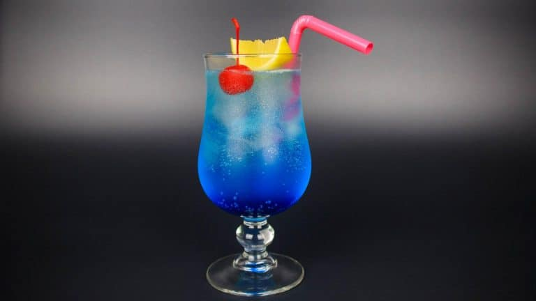 Blue lagoon cocktail with a straw and fruit inside